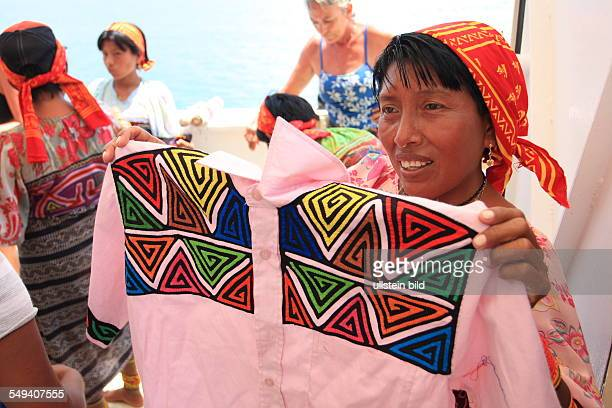 PAN Panama central America San Blas Coco Banderos Cays island group in the area Kuna Yala women offering arts and crafts