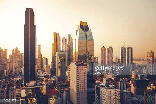 panama city skyline at sunset, panama - panama city panama stock pictures, royalty-free photos & images