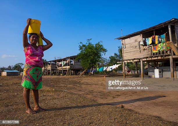 Panama Darien province Alto Playona Woman of the native indian Embera tribe carrying water on the head on April 13 2015 in Alto Playona Panama