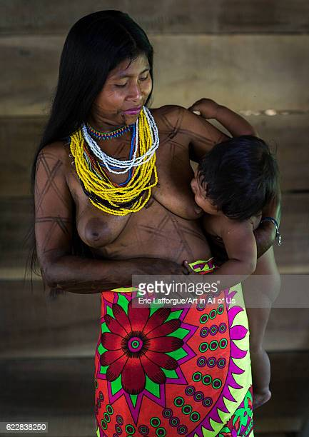 Panama Darien province Bajo Chiquito Woman of the native indian Embera tribe breastfeeding her baby on April 13 2015 in Bajo Chiquito Panama