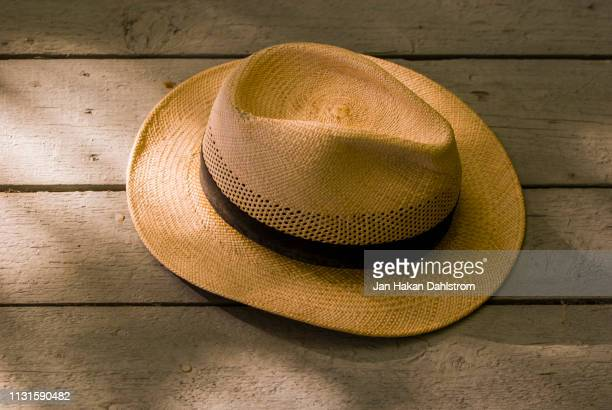 panama hat hanging on wall - straw hat stock pictures, royalty-free photos & images
