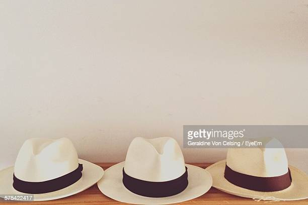 Panama Hats On Table Against Wall