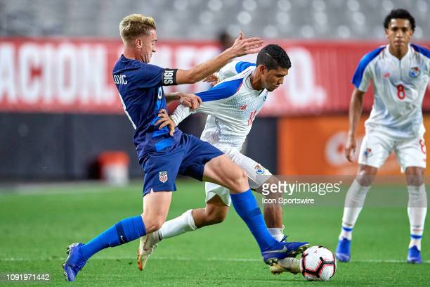 Panama midfielder Edgar Gondola battles with United States midfielder Djordje Mihailovic in game action during an international friendly match...