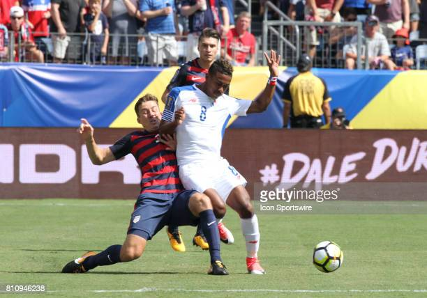 Panama midfielder Edgar Yoel Barcenas fends off the United State's Omar Gonzalez during the CONCACAF Gold Cup soccer match between USA and Panama on...