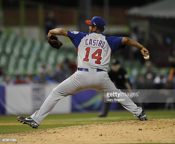 Panama pitcher Yeliar Castro winds up off the mound during the Pool D game three between the Dominican Republic and Panama during the the first round...