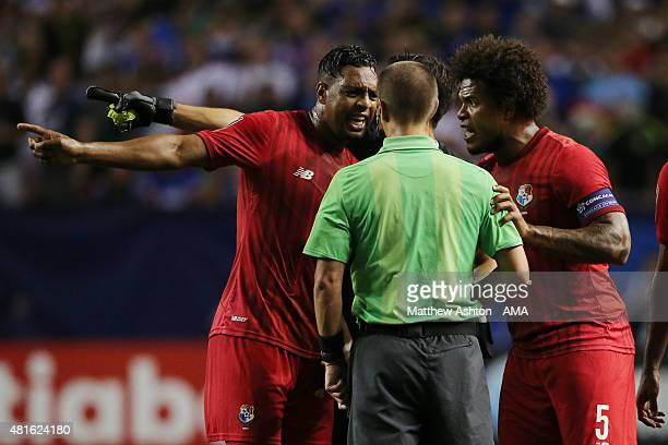 Panama players confront Referee Mark Geiger after he awarded a red card during the CONCACAF Gold Cup 2015 Semi Final between Panama and Mexico at...