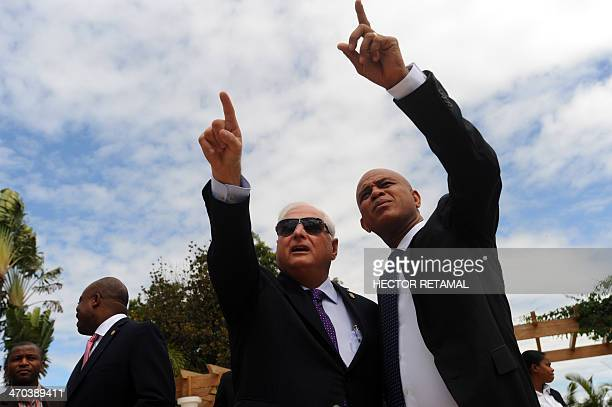 Panama President Ricardo Martinelli with the President of Haiti Michel Martelly as they look at a hotel in Port au Prince on February 19 after a...