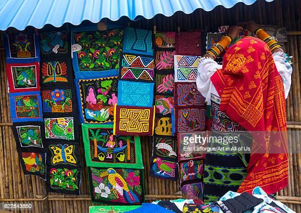 Panama San blas islands Mamitupu Kuna woman in traditional outfits selling colorful hand stitched Kuna indian molas on April 16 2015 in Mamitupu...