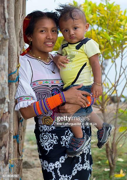 Panama San blas islands Mamitupu Portrait of Kuna tribe mother holding her baby on April 17 2015 in Mamitupu Panama