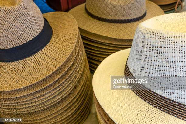 panama style hats on sale in the mercado municipal - the main market in tavira, algarve, portugal - peter adams stock pictures, royalty-free photos & images