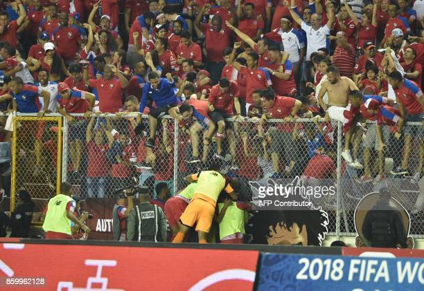 Panama teammates and fans celebrate after Panama qualifies for the World Cup for the first time ever in their qualifier football match Costa Rica in...