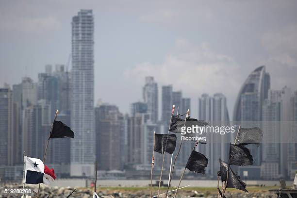 A Panamanian flag waves next to black flags on top of fishing boats in Panama City Panama on Tuesday April 5 2016 For decades Jurgen Mossack and...