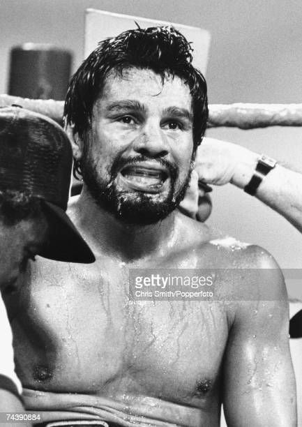 Panamanian lightweight boxer Roberto Duran also known as 'Hands of Stone' rests between round circa 1980