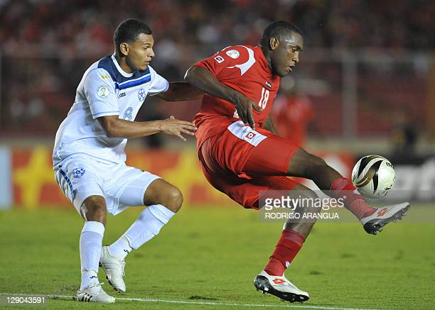 Panamanian Luis Tejada and Donald Parrales from Nicaragua vie for the ball during their Brazil 2014 FIFA World Cup Concacaf qualifiers match held at...