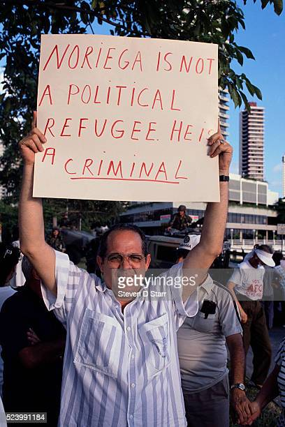 A Panamanian man holds up a sign that reads 'Noriega is not a political refugee He is a criminal' The United States invaded Panama in 1989 to bring...