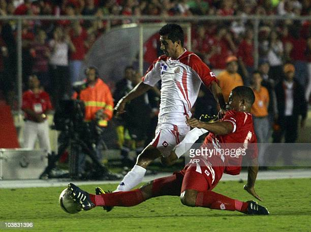 Panamanian national footballer Josue Martinez marks Costa Rican Ramon Torres during a friendly match held at the Rommel Fernandez stadium in Panama...