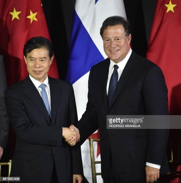 Panamanian President Juan Carlos Varela and Chinese Minister of Commerce Zhong Shan shake hands during a press conference at the Simon Bolivar Palace...