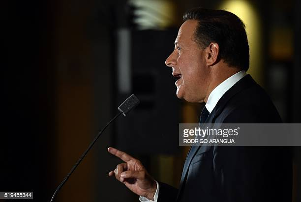 Panamanian President Juan Carlos Varela delivers a speech at Bolivar Palace after a meeting with foreign ambassadors following the massive leak...