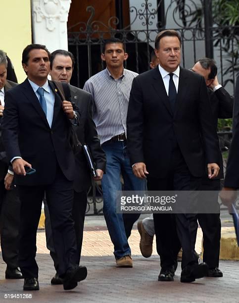 Panamanian President Juan Carlos Varela heads to Bolivar Palace after a meeting with foreign ambassadors in Panama City on April 6 following the...