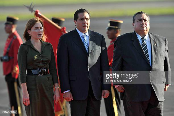 Panamanian President Martin Torrijos and his wife Viviana Fernandez sing Panama's national anthem next to El Salvador's Vice Foreign Minister Luis...