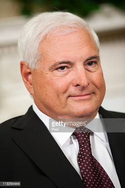 Panamanian President Ricardo Martinelli listens as US President Barack Obama talks to reporters after their meeting in the Oval Office at the White...