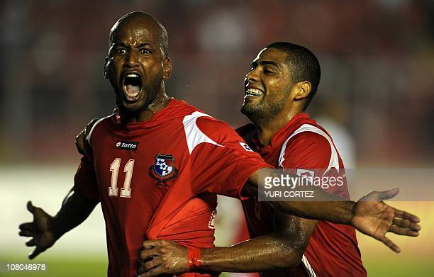 Panamanian Roberto Brown celebrates with teammate Gabriel Gomez after scoring the second goal for his team against Belize during their UNCAF Coup...