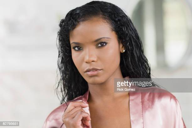 Panamanian woman in silk robe looking serious