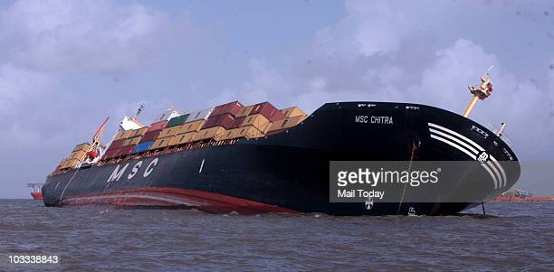 Panamanian-registered container ship MSC Chitra that collided Saturday with the MV-Khalijia-II, a St. Kitts registered ship, lists in the Arabian Sea...