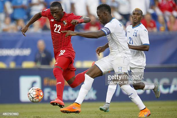 Panama's Abdiel Arroyo carries the ball upfield under pressure from Honduras' Maynor Figueroa during the CONCACAF Gold Cup match between Honduras and...