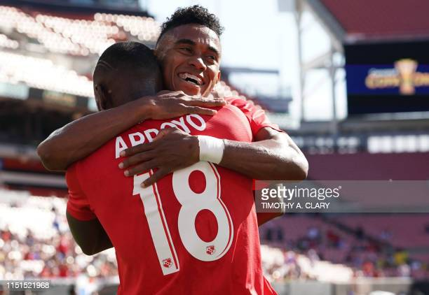 Panama's Alberto Quintero hugs Abdiel Arroyo after scoring against Guyana during their CONCACAF Gold Cup group stage football match at First Energy...