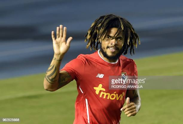 Panama's footballer Roman Torres waves to supporters during a training session of the national football team ahead of the FIFA 2018 World Cup at the...