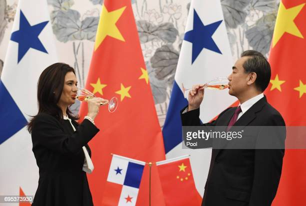 Panama's Foreign Minister Isabel de Saint Malo and Chinese Foreign Minister Wang Yi drink a toast after signing a joint communique on establishing...