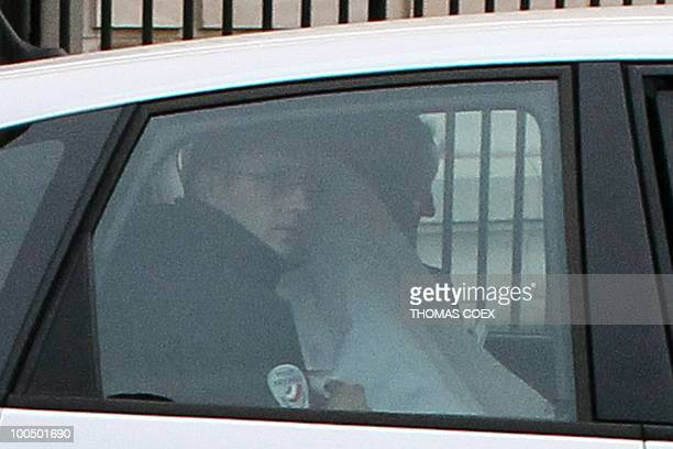 Panama's former dictator Manuel Noriega hidden under a white fabric leaves in a car Paris' court house on April 27 2010 Manuel Noriega extradited to...