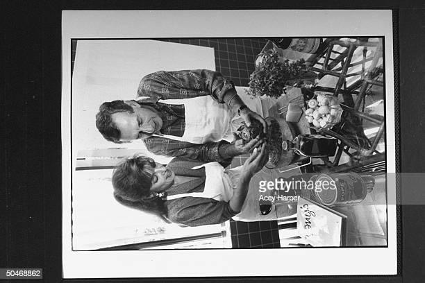 Panama's Gen Manuel Noriega's defense attorney Frank Rubino helping his wife Ann stuff artichokes in their kitchen