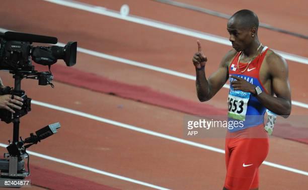 Panama's Irving Jahir Saladino Aranda gestures in front of a camera as he celebrates winning the men's Long Jump final at the National Stadium as...