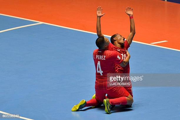 Panama's Michael De Leon celebrates with Panama's Jorge Perez his goal against Uzbekistan during the first round match of the FIFA Futsal World Cup...