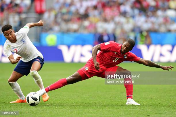 Panama's midfielder Armando Cooper challenges England's midfielder Jesse Lingard during the Russia 2018 World Cup Group G football match between...
