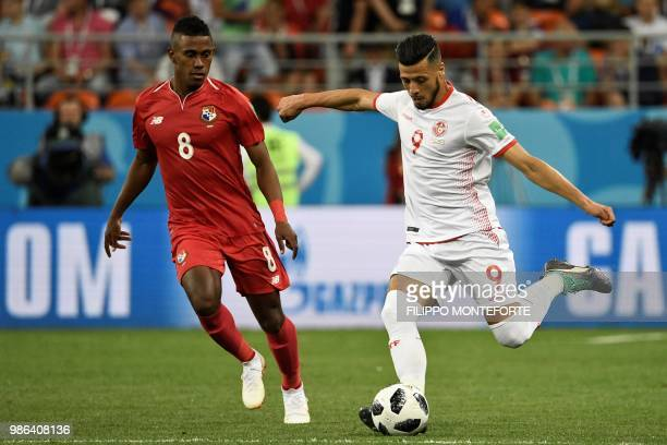 Panama's midfielder Edgar Barcenas vies with Tunisia's forward Anice Badri during the Russia 2018 World Cup Group G football match between Panama and...
