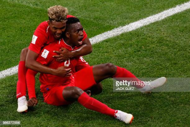 TOPSHOT Panama's midfielder Jose Luis Rodriguez celebrates with teammate Panama's midfielder Ricardo Avila after scoring during the Russia 2018 World...