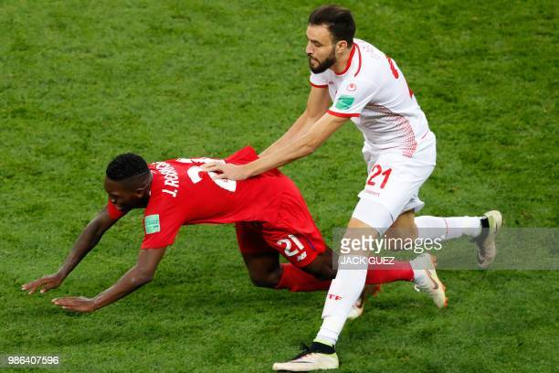 Panama's midfielder Jose Luis Rodriguez fights for the ball with Tunisia's defender Hamdi Nagguez during the Russia 2018 World Cup Group G football...