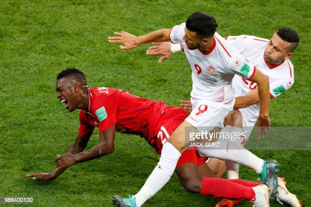 Panama's midfielder Jose Luis Rodriguez vies with Tunisia's forward Anice Badri during the Russia 2018 World Cup Group G football match between...