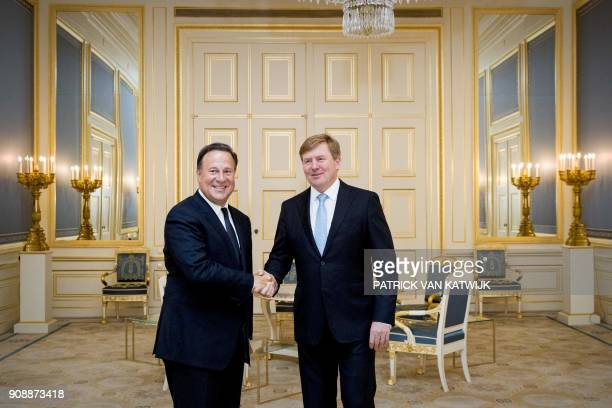 Panama's President Juan Carlos Varela and Netherlands' King WillemAlexander shake hands at the Royal Palace Noordeinde in The Hague on January 22...