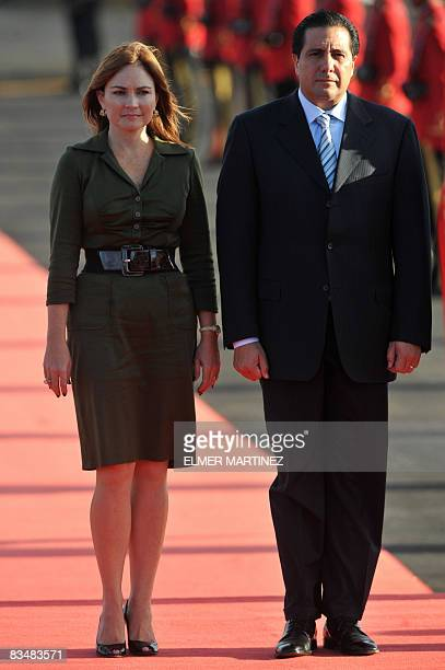 Panama's President Martin Torrijos and his wife Viviana Fernandez listen to the national anthem upon their arrival to El Salvador's airport in...