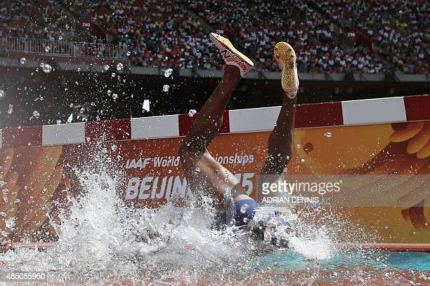 Panama's Rolanda Bell falls into the water jump during the heats of the women's 3,000 metres steeplechase athletics event at the 2015 IAAF World...