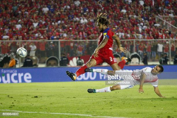 Panama's Roman Torres kicks to score during their 2018 World Cup football qualifier match against Costa Rica in Panama City on October 10 2017 Panama...