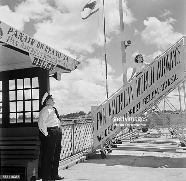 PanAmerican World Airways stewardess stands on the stairway at Val de Cans International Airport in BelemBrazil