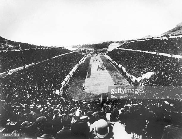 Panaromic view of the 1896 Olympic Games held in a crowd-filled stadium in Athens, Greece.