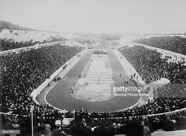 A panaromic view of the 1896 Olympic Games held in a crowdfilled stadium in Athens Greece