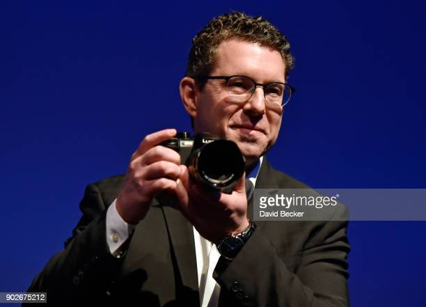 Panasonic Consumer Electronics Company President Michael Moskowitz displays the Lumix GH5S mirrorless camera during a press event for CES 2018 at the...