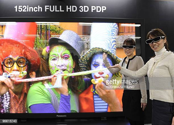 Panasonic employees unveil a prototype model of the world's largest 152inch sized plasma display panel during a press preview at the company's plant...